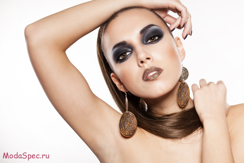 girl with a long hair and beautiful face with smoky eyes