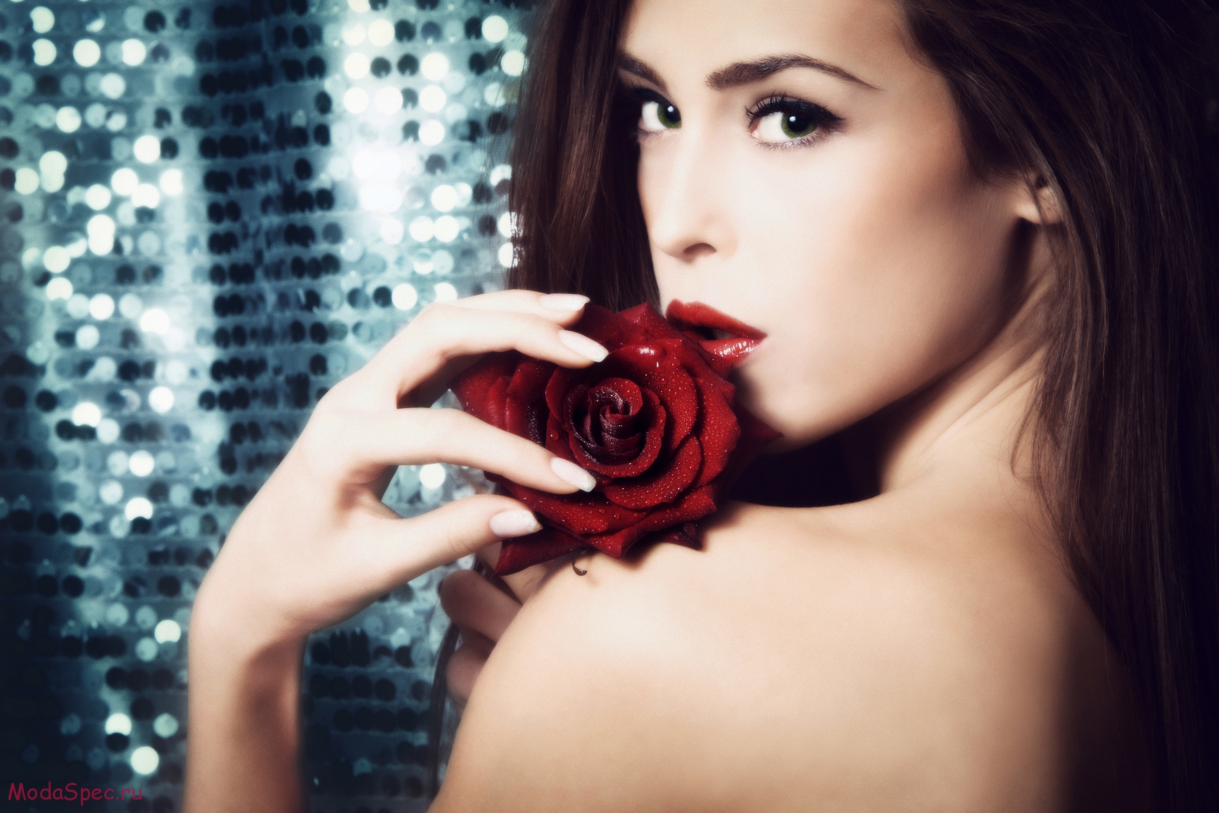 young woman beauty portrait with red rose in front of glowing background small amount og grain added